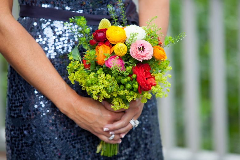 maid of honor holding a wedding bouquet