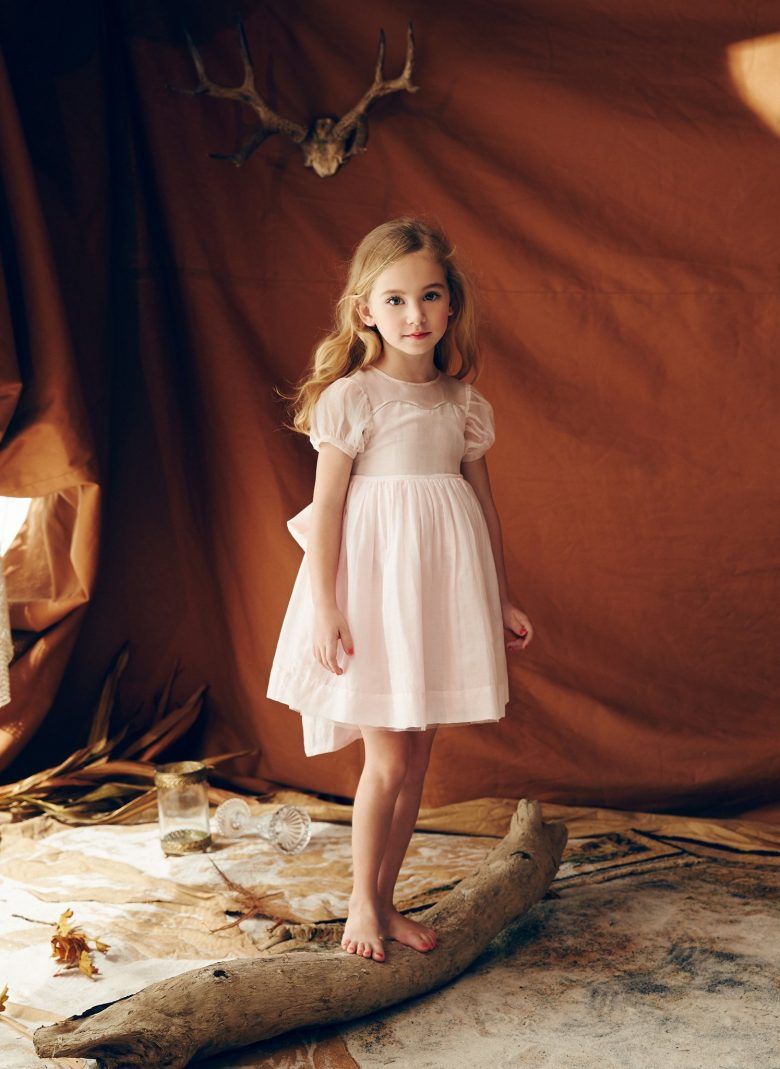old fashioned pink dress on a little girl