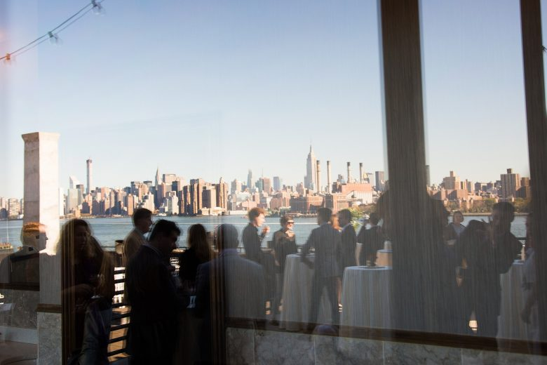wedding guests at reception with view of city skyline