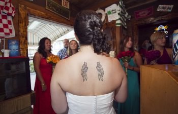 Bride's back with angel wing tattoo