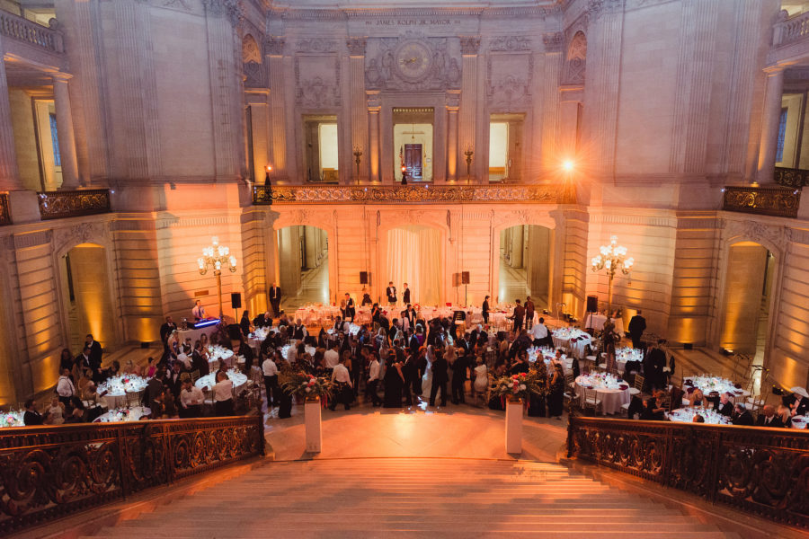 Formal wedding reception inside a historic and opulent building
