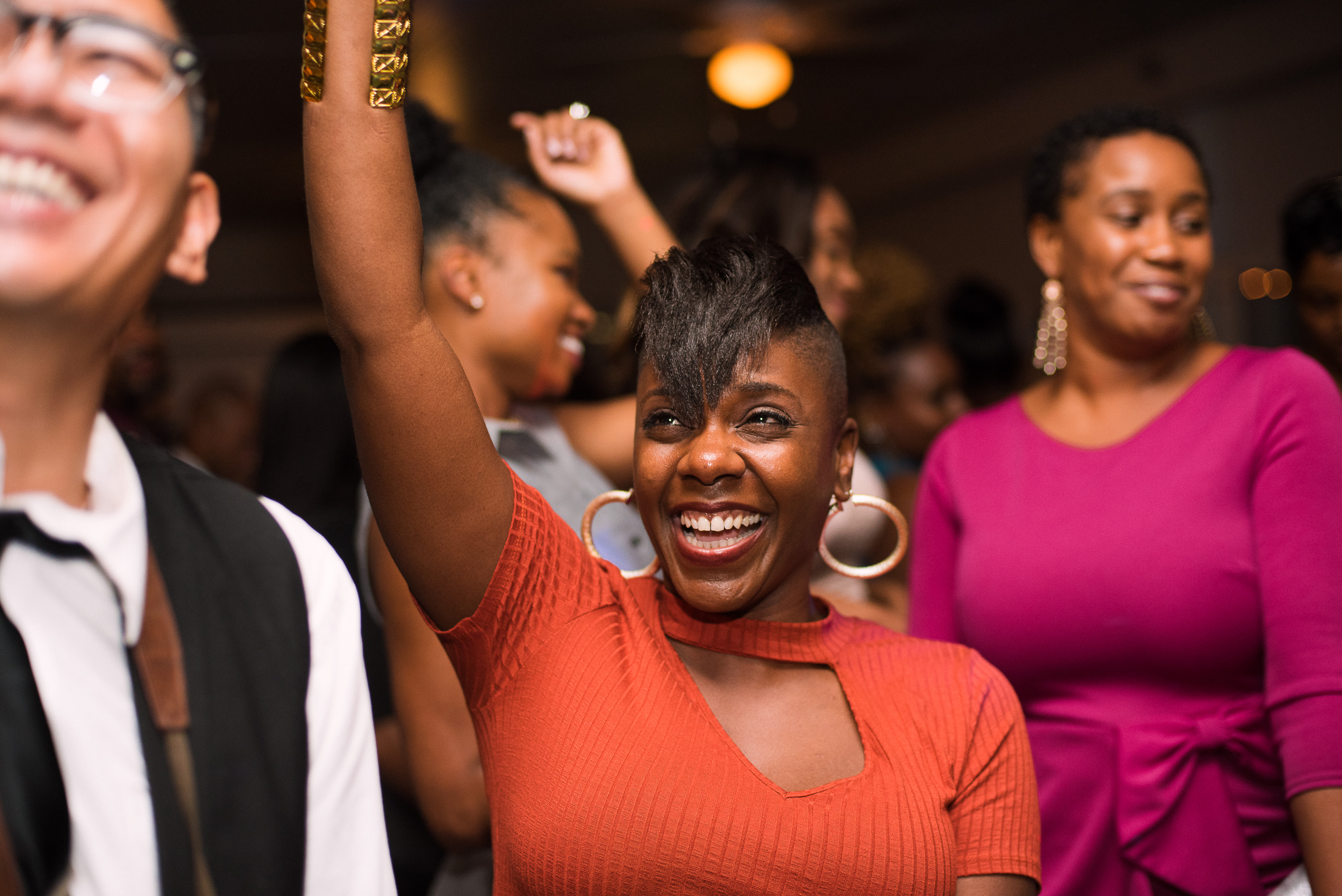 A woman dancing at a wedding reception
