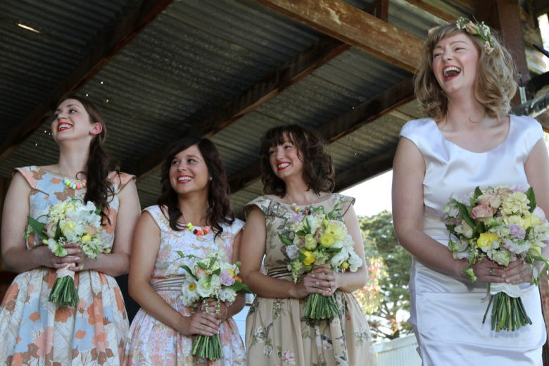laughing bride and bridesmaids
