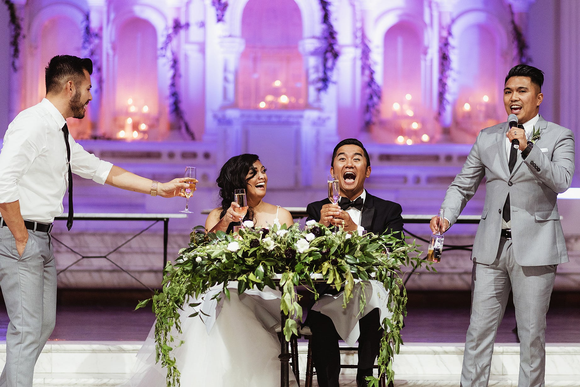 A Julie Pepin photo depicting a bride and groom laughing at a toast