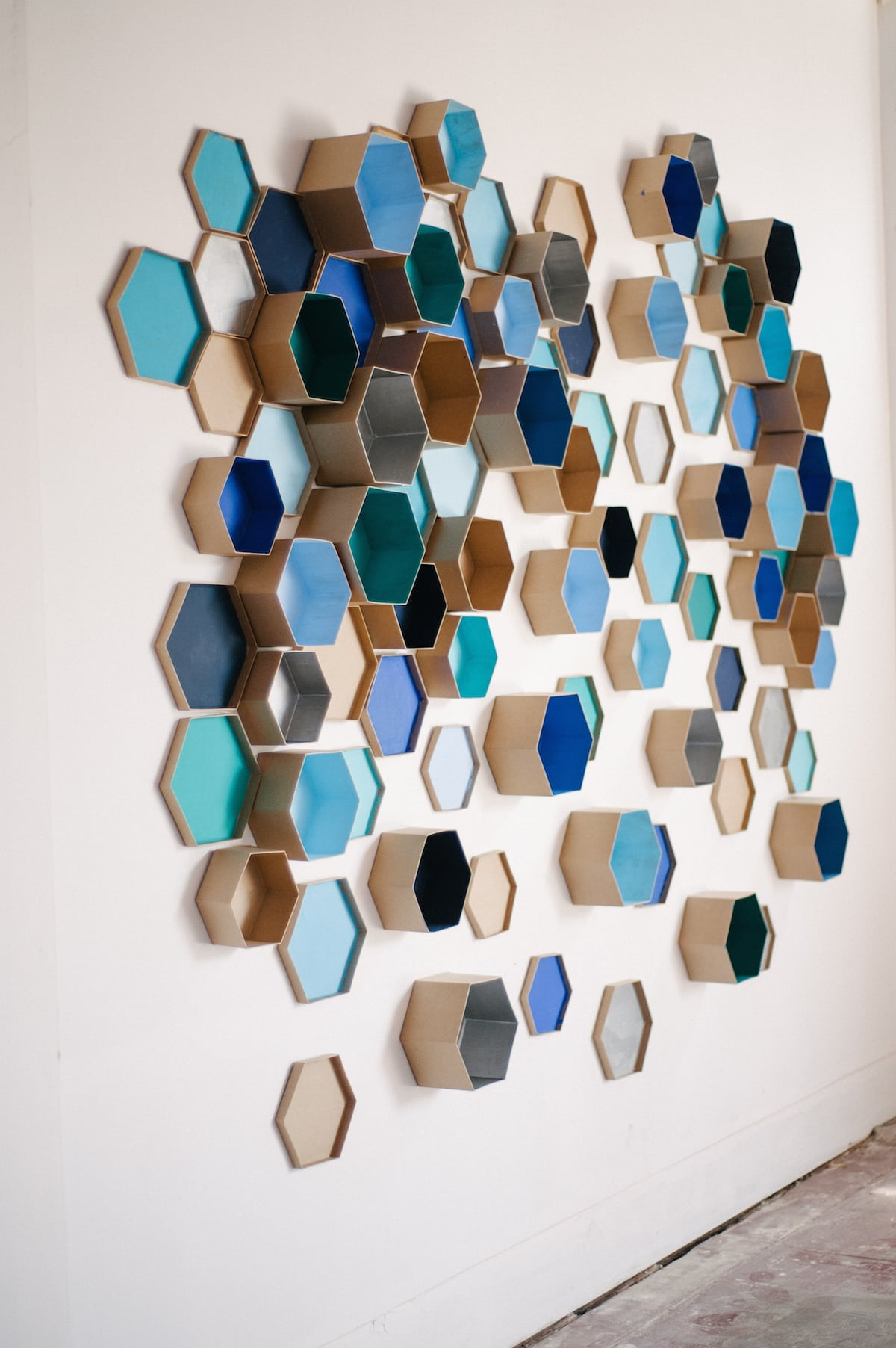 a wall covered with hexagon shapes for a DIY photo booth backdrop