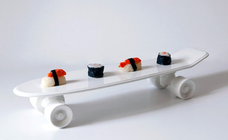 a white ceramic skateboard sushi plate isn't your everyday anniversary gift