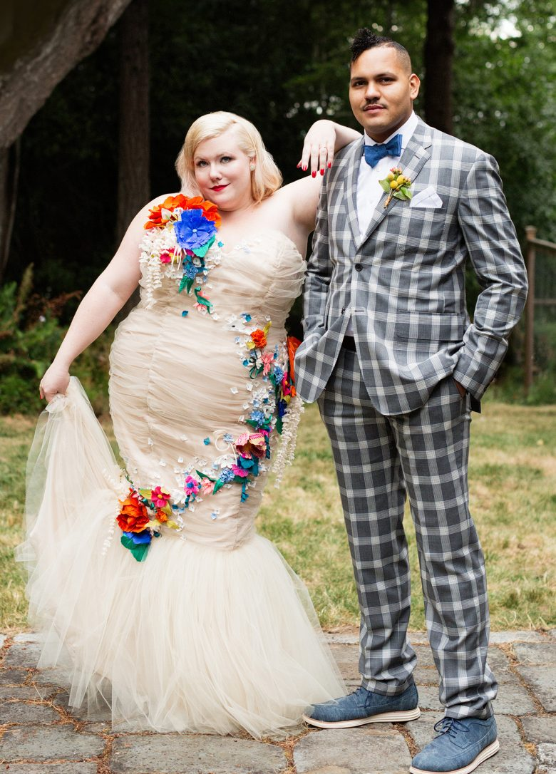 Lindy West, blonde curvy in long gown with arm on the shoulder of husband in checkered suit | A Practical Wedding