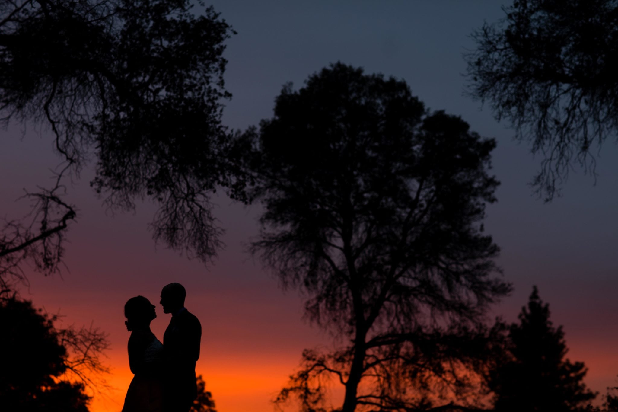 a man and woman at sunset