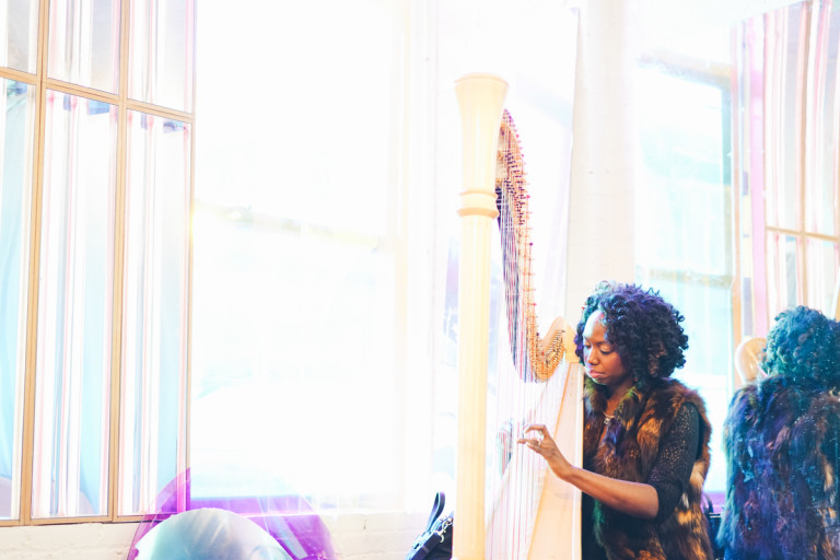 a harpist plays during a reception