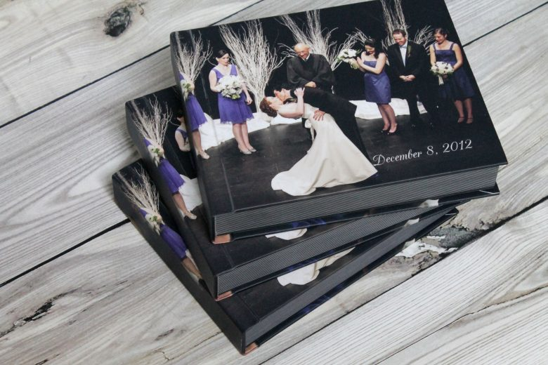 stack of flush mount wedding photo albums