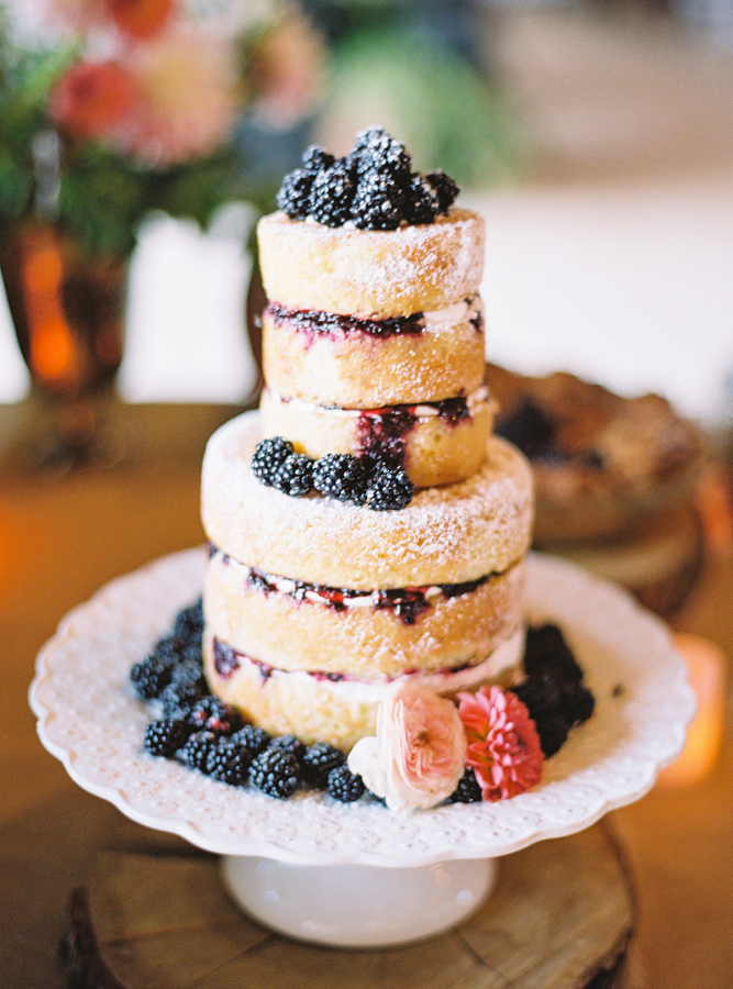 Naked cake covered in blackberries
