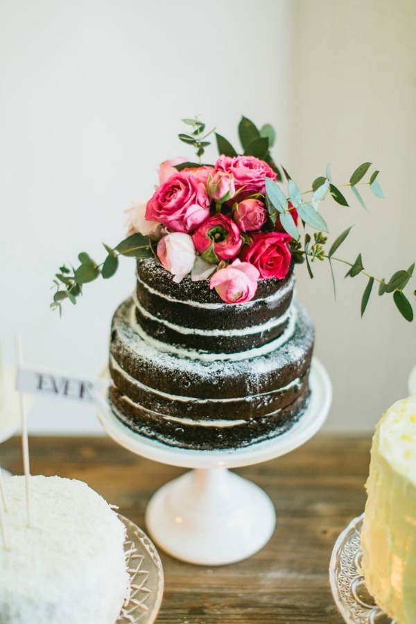 chocolate cake with powdered sugar and roses