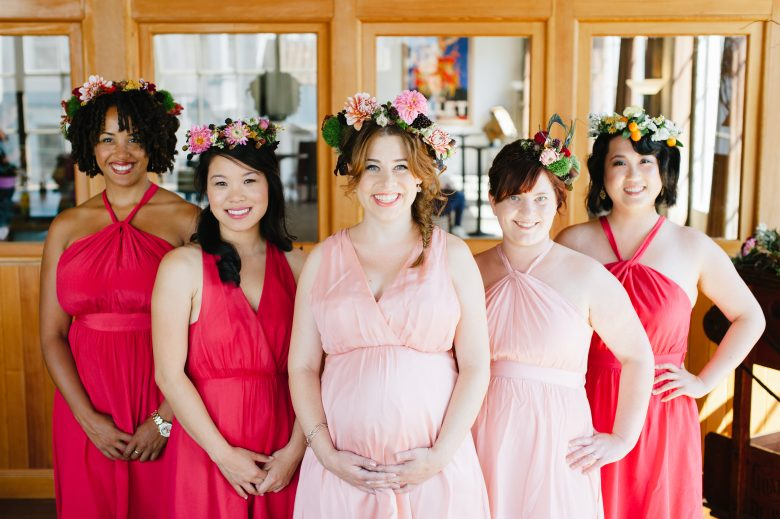 hot pink and light pink bridesmaids with mismatched bridesmaids hairstyles and flower crowns