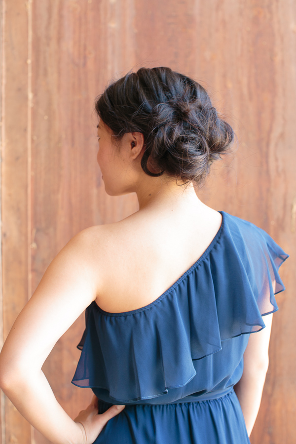 curly side bun bridesmaid hairstyle