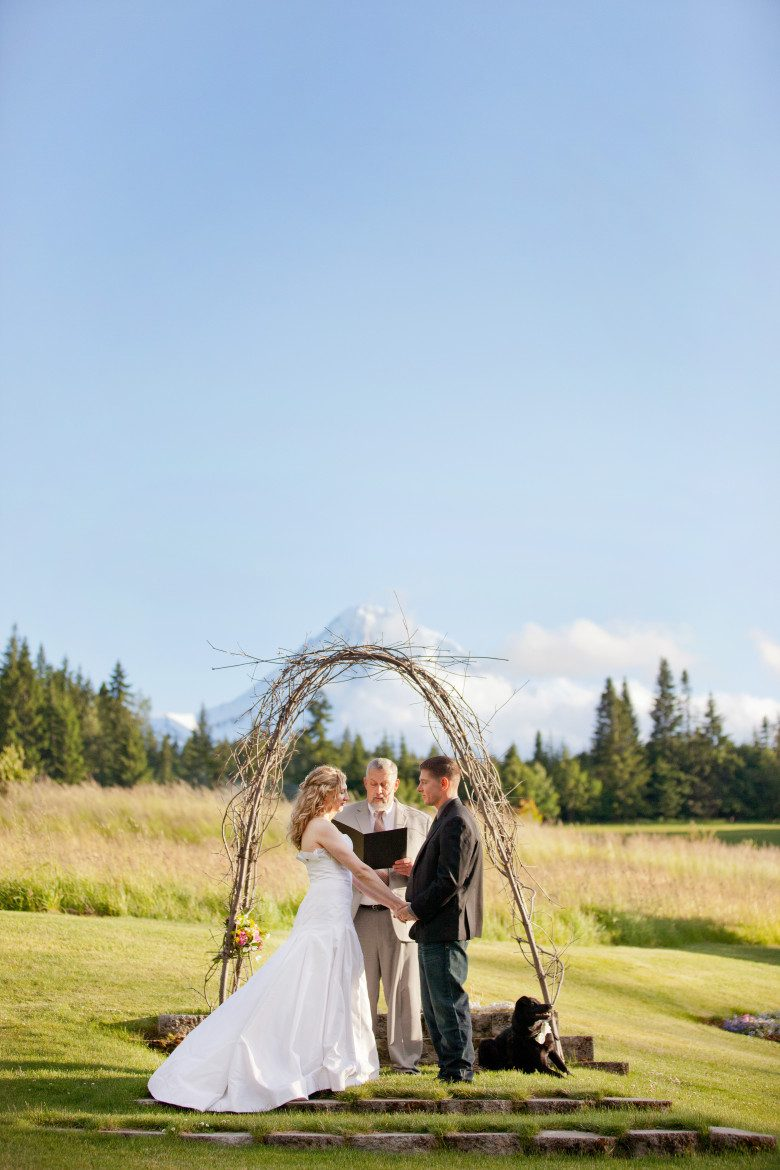 couple eloping in a ceremony in front of mt hood