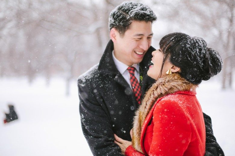 bride and groom standing in the snow