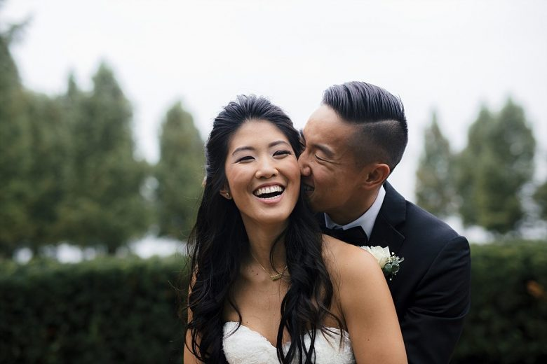couple laughing together on their wedding day
