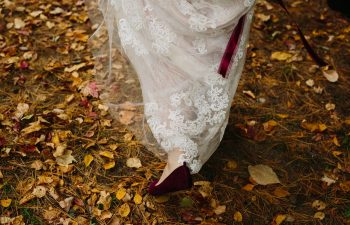 bride walking in leaves