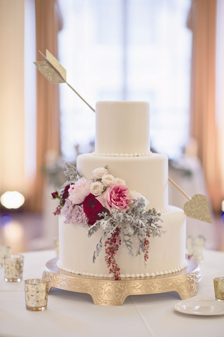 cake with flowers and an arrow