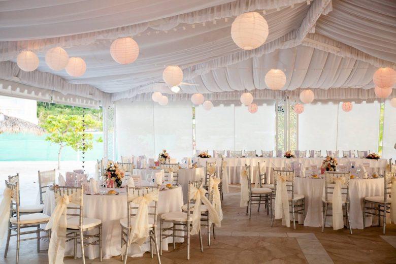 destination wedding tent with lanterns and white decor