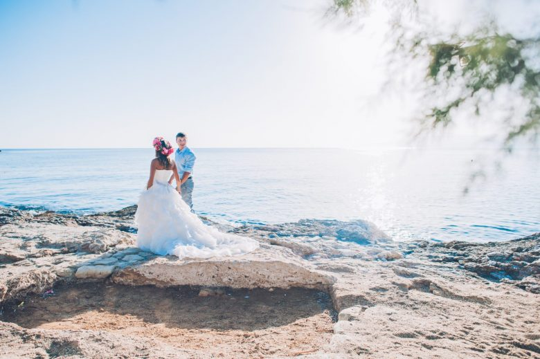 Couple on beach with flower crown at Destination Wedding