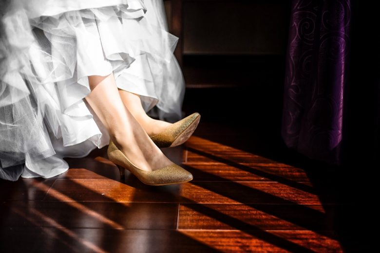 bride wearing gold glitter shoes