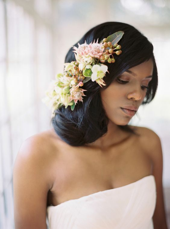 side twist on black hair with flowers