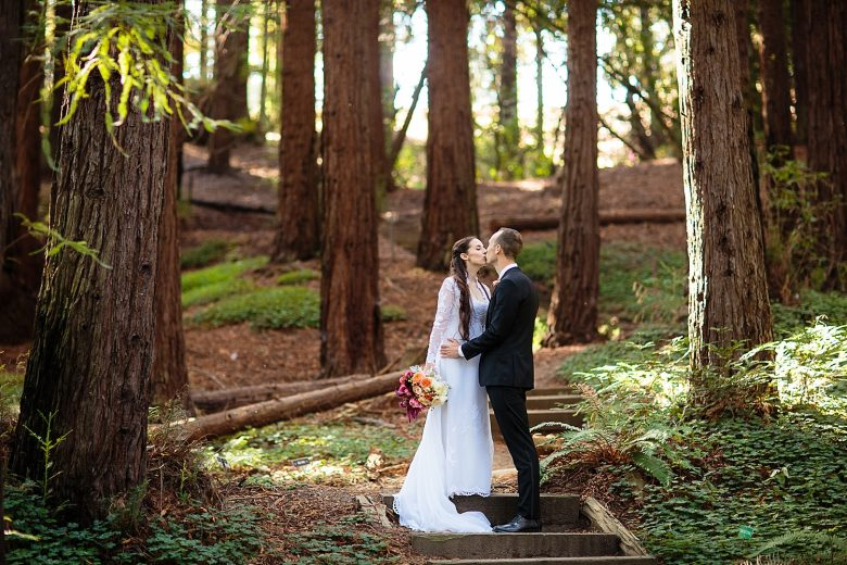 a couple in a redwood forest on their wedding day