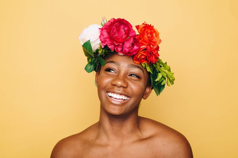 woman wearing a flower crown and laughing