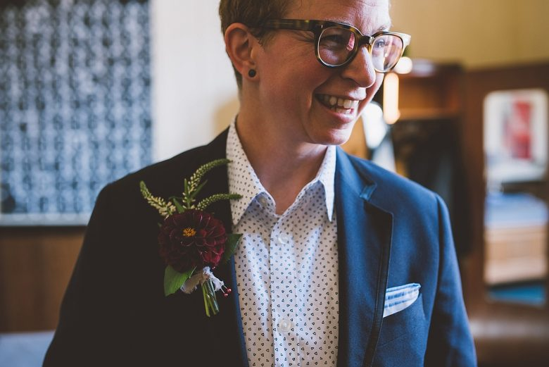 Author on wedding day, wearing a suit jacket and boutonnière