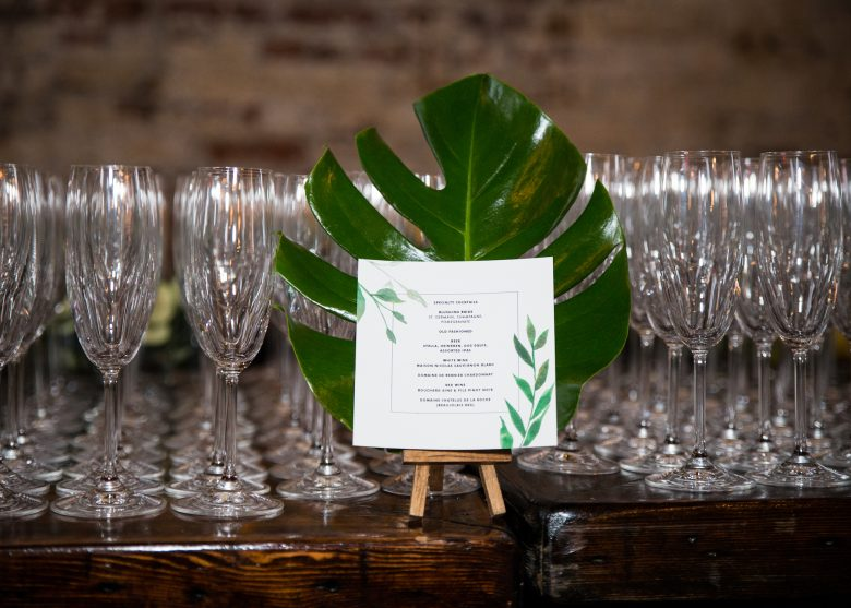 botanical cocktail menu by Bojack Studios with leaf and champagne glasses