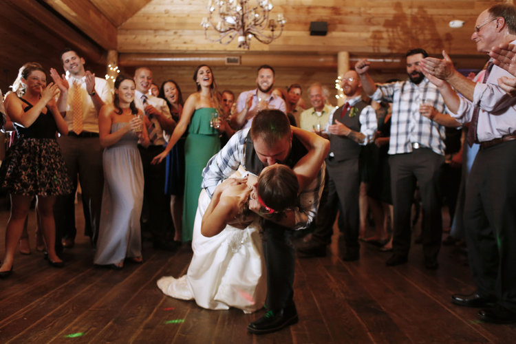 Newly weds on dance floor kissing in a deep dip