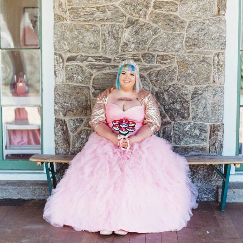 bride with unicorn hair and tiara, wearing pink wedding dress and sparkling bolero, with pokemon ball bouquet