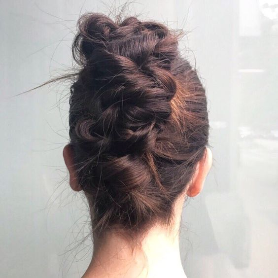 Messy twisted and braided french twist, with the front tightly pulled back, from behind for a wedding hairstyle