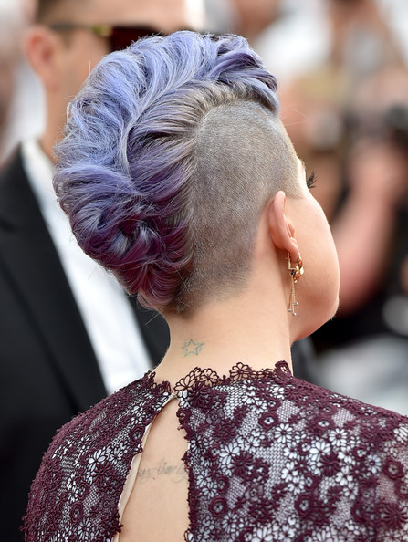 Kelly Osborn from behind with lavender locks, shaved into a wide mohawk and curled into a faux-hawk—inspiration for a wedding hairstyle