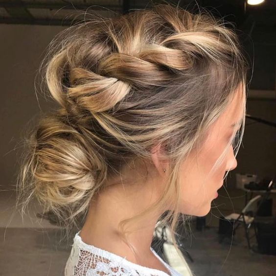 messy loose french braid from front hairline gathered into loose chignon for a wedding hairstyle