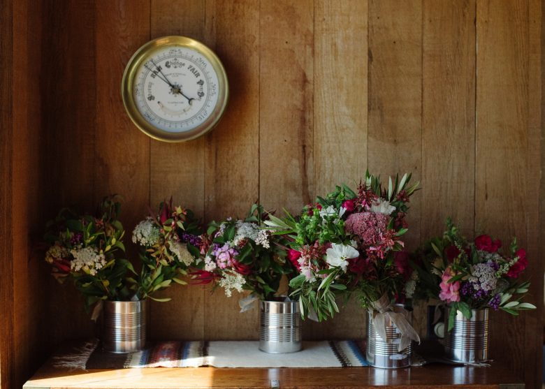 bridal bouquets in tin cans