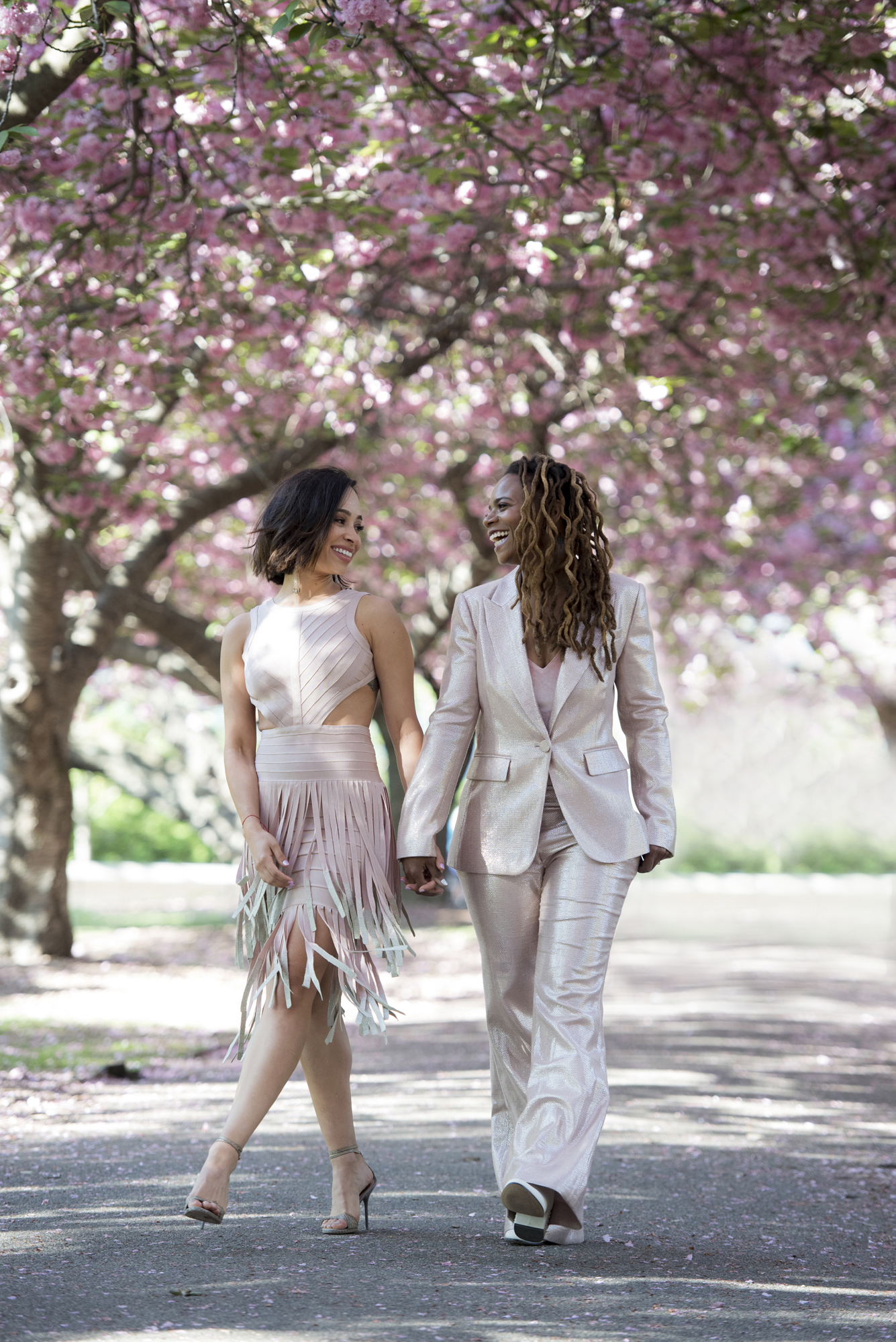 Two women walk down a path in the park