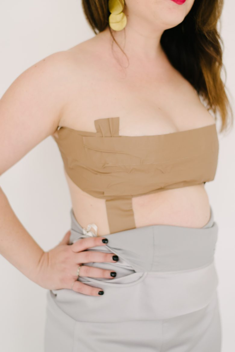 sideview of strapless gaffer tape bra on brunette