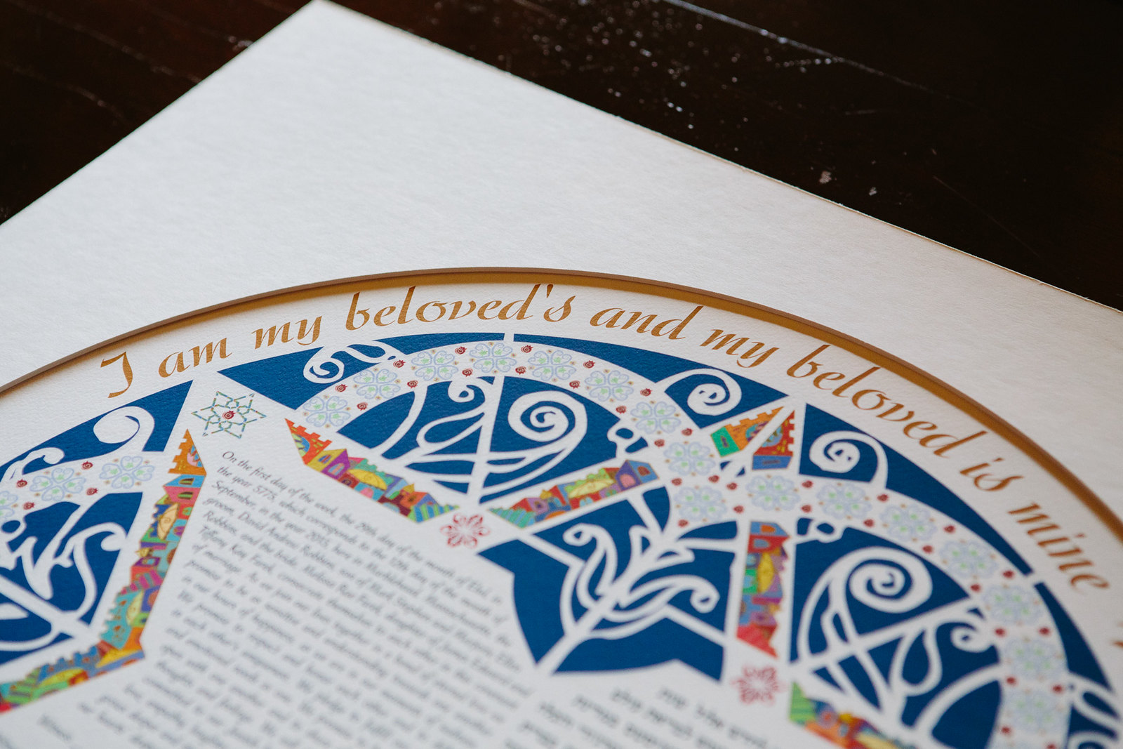 "a close up of a ketubah that says ""I am my beloved's and my beloved is mine"""