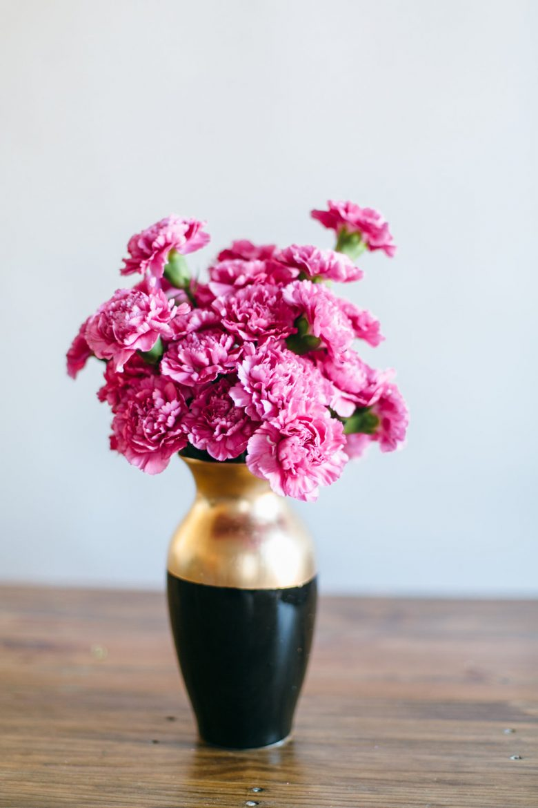 hot pink carnations in a diy painted metallic gold vase