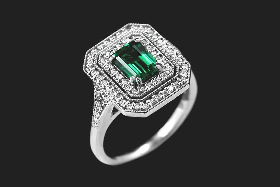 vintage inspired cocktail diamond engagement ring with ethical emerald center stone