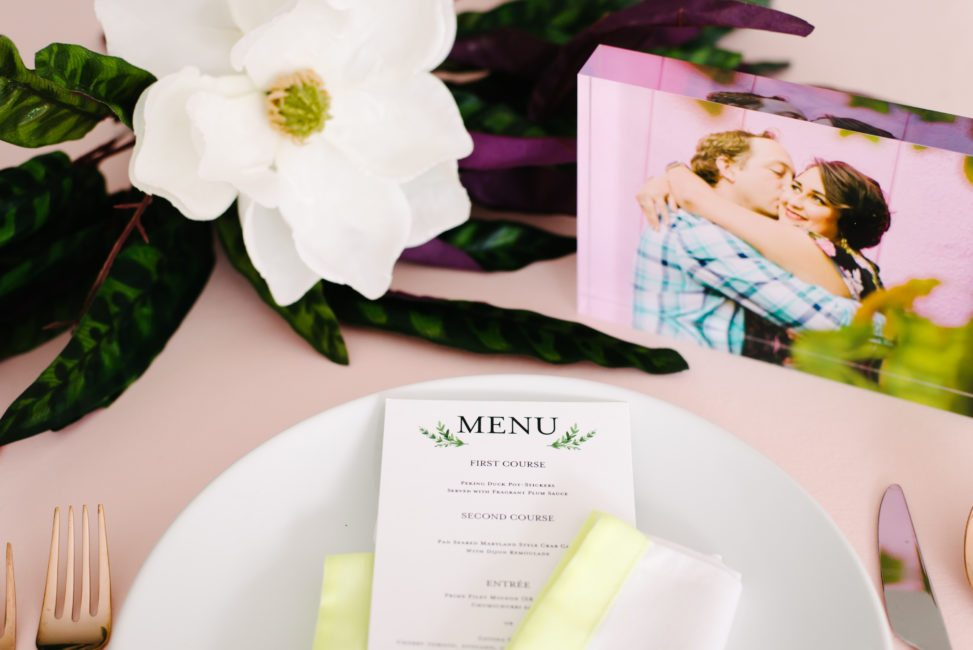 acrylic block print next to silk flowers and a printed menu from shutterfly