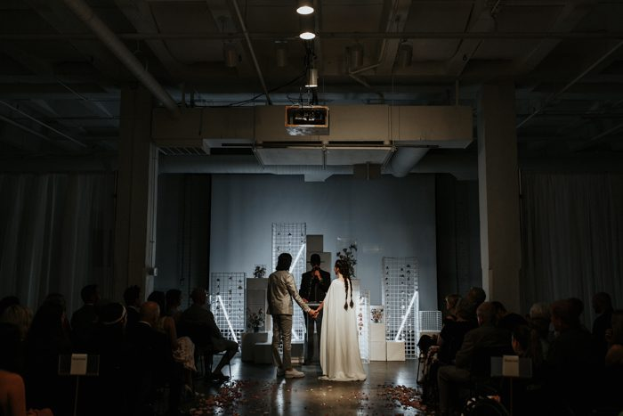 couple getting married in front of an art instillation