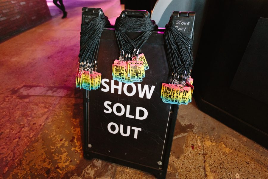 "concert passes on a concert ""sold out"" sign"