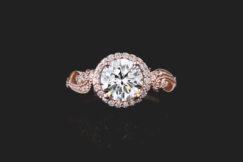 rose gold ethical engagement ring with round diamond and halo setting