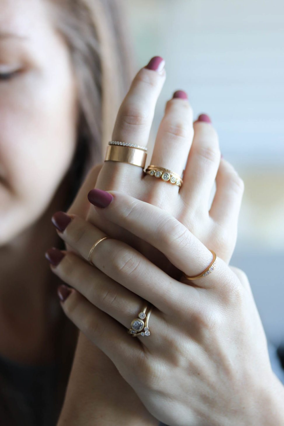 Woman holde her hands, wearing many rings