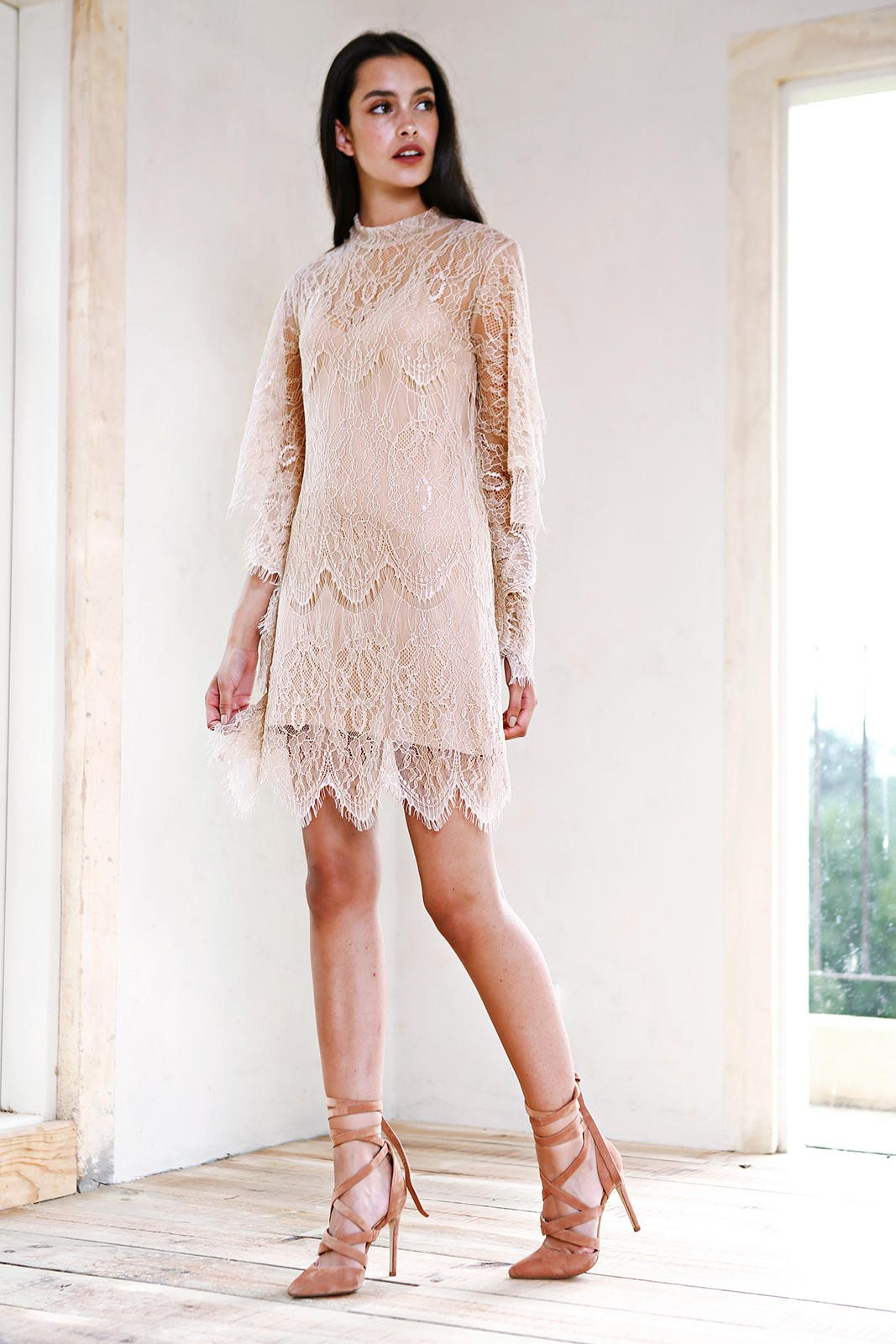 woman wearing a High Neck lace Shift dress