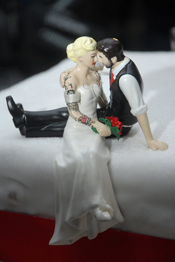 tattooed couple sitting cake topper