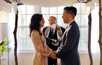 Wedding couple under a chuppah in their living room